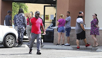 Click image for larger version  Name:A man leaves a gun store in Casselberry, Fla., in March. (Joe Burbank - AP.jpg Views:16 Size:81.5 KB ID:45571